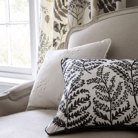 Clarke and Clarke -  Wild Garden Fabric Collection - Curtains and cushions of floral fabric in black, white and grey in a monochromatic setting