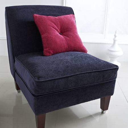 Clarke and Clarke -  Zuma Fabric Collection - Dark purple upholstered chair with plain red cushion with button in the middle