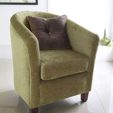 Clarke and Clarke -  Zuma Fabric Collection - Green upholstery on chair and purple cushion with button in centre