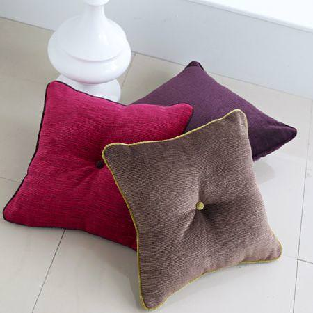 Clarke and Clarke -  Zuma Fabric Collection - Cushions in red, purple and brown with buttons in centre and different colour lining