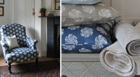 Cloth and Clover -  Cloth and Clover Collection - White circular patterns on plain navy and grey fabrics, covering an armchair and two cushions, with white fabric rolls