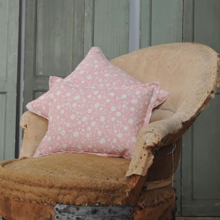 Cloth and Clover -  Cloth and Clover Collection - A distressed warm brown fabric covered chair with two square scatter cushions, both in pale pink and white floral fabric