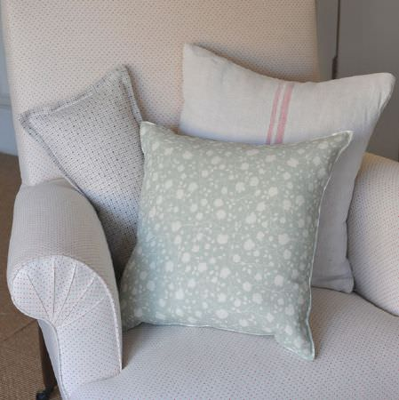 Cloth and Clover -  Cloth and Clover Collection - White and very pale shades of grey making up stripes, dots, patterns and florals on three scatter cushions and an armchair