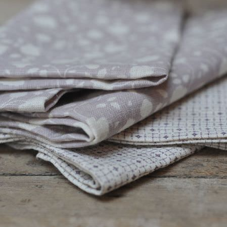 Cloth and Clover -  Cloth and Clover Collection - Four folds of iron grey and white fabric; two featuring simple florals, and two with small geometric patterns