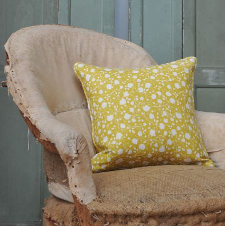 Cloth and Clover -  Cloth and Clover Collection - A distressed cream and hessian covered armchair with a square scatter cushion covered with white and gold florals