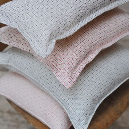 Cloth and Clover -  Cloth and Clover Collection - Small geometric prints covering a stack of four scatter cushions made in white, red, blue, grey and pastel pink