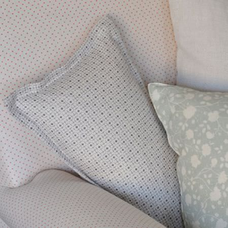 Cloth and Clover -  Cloth and Clover Collection - Small geometric prints and subtle florals covering two cushions and an armchair in white and light shades of grey and pink