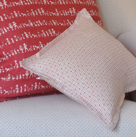 Cloth and Clover -  Cloth and Clover Collection - Red and white fabrics featuring fun prints and small geometric patterns covering two cushions, on a dot print armchair