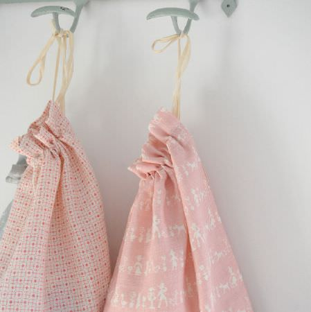 Cloth and Clover -  Cloth and Clover Collection - Two grey hooks with two drawstring bags made from baby pink and white patterned and geometric print fabrics