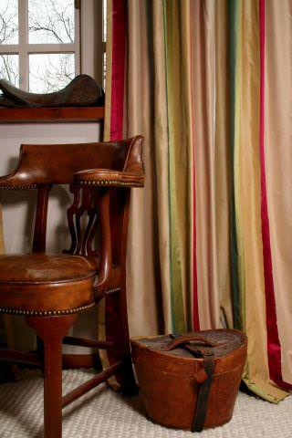 Design Forum -  Albany Fabric Collection - Gold coloured curtain with red and green stripes in a country house setting