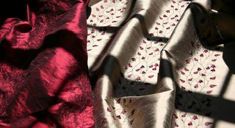 Design Forum -  Opium Silks Fabric Collection - Deep red plain silk fabric and gold silk with red foliage design