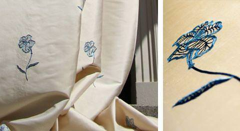 Design Forum -  Opium Silks Fabric Collection - Champagne white silk fabric with occasional blue stitched flowers