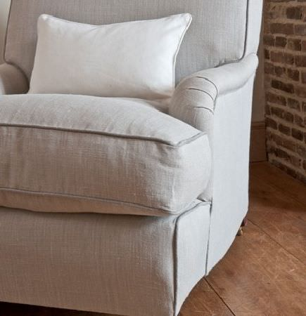 Design Forum -  Pluto Fabric Collection - Putty coloured armchair with thick seat cushion and off-white scatter cushion