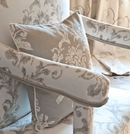 Design Forum -  Tuscany Fabric Collection - Padded white armchair with grey floral pattern, with an inversely coloured cushion