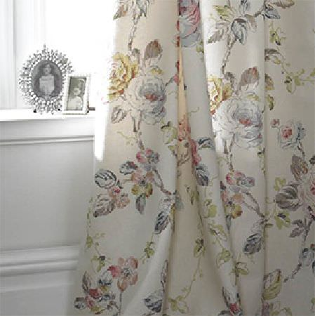 Edinburgh Weavers -  Rose Is A Rose Fabric Collection - Floral print curtains with a large pattern in pale grey, green and pink shades on an off-white background, with small decorative silver frames