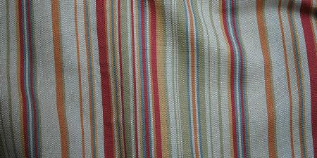 Elanbach -  Fair and Square Fabric Collection - Dusky shades of grey, green, gold, red and blue making up a swatch of fabric with a random striped pattern