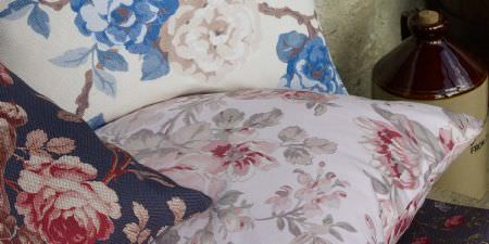 Elanbach -  In The Country Fabric Collection - Three cushions with a vintage floral pattern in creams, blues, pinks and greens