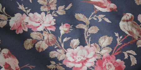 Elanbach -  In The Country Fabric Collection - Fabric with a blue background, pink flowers, and champagne coloured stems and leaves