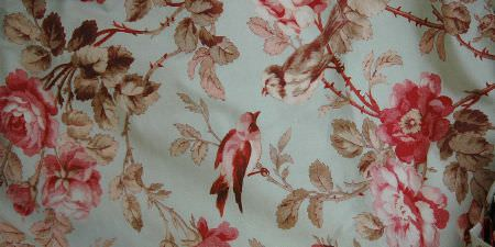 Elanbach -  In The Country Fabric Collection - A pink and green-grey design of birds, leaves and flowers on a pale blue fabric