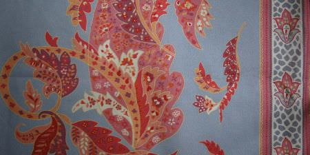 Elanbach -  Something Thirties Fabric Collection - Blue fabric with a curving leaf design in cream, red, terracotta, pink and purple, and a coloured, patterned border