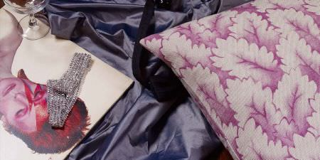 Elanbach -  Something Thirties Fabric Collection - Midnight blue satin effect fabric, with a pink and cream oak leaf cushion, a strip of sequins and a wine glass