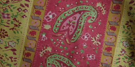 Elanbach -  Spice Route Fabric Collection - Fabric featuring flowers and paisley shapes in shades of pink, green, yellow, white and purple