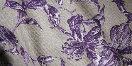 Elanbach -  Top Toiles Fabric Collection - Putty coloured fabric with a purple pattern of large lilies