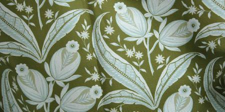 Elanbach -  Tree of Life Fabric Collection - Patterned fabric featuring leaf, flower and bud designs in white and pale blue, on an Army green backdrop