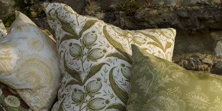 Elanbach -  Tree of Life Fabric Collection - Three green and white cushions, each with a different floral pattern