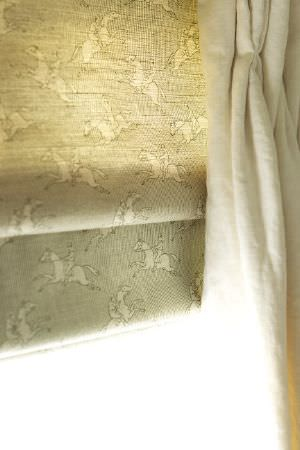 Emily Bond -  Country Fabric Collection - Window blinds in light grey, printed with small cream coloured jumping horses, hanging besidetucked cream coloured curtains which are plain