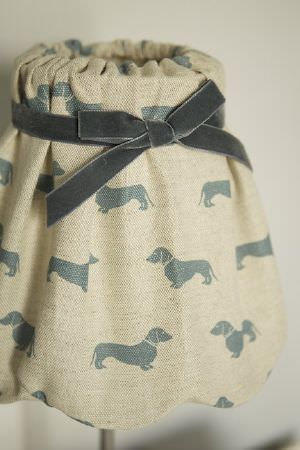 Emily Bond -  Dogs Fabric Collection - Gathered fabric lampshade in a cream-champagne colour, printed with tiny grey daschunds and finished with a velvet effect grey ribbon
