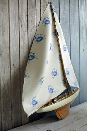 Emily Bond -  Seaside Fabric Collection - Seaside-inspired design featuring a pattern of blue crabs on simple fabric dyed in light beige
