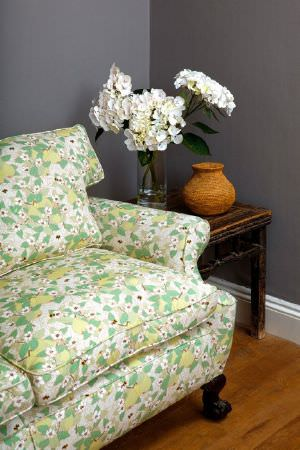Emily Burningham -  Emily Burningham Fabric Collection - Sofa in mottled white daisy fabric with summery green leaf effect.