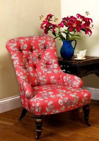 Emily Burningham -  Emily Burningham Fabric Collection - Occasional chair in bright reddish pink fabric with cream, white and grey floral effect pattern.
