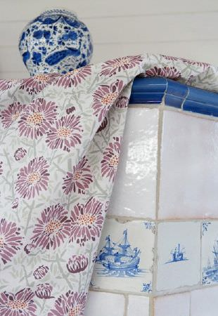 Emily Burningham -  Emily Burningham Fabric Collection - Simple modern fabric dyed in white decorated with a pattern of purple flowers that have grey stems