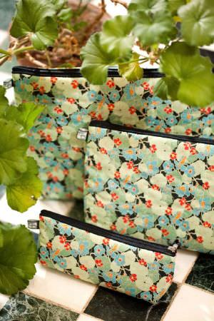 Emily Burningham -  Emily Burningham Fabric Collection - Fabric with cream, orange and shades of green creating a mottled  effect.