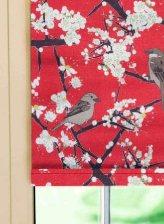 Emily Burningham -  Emily Burningham Fabric Collection - Roman Blind with red background with dark branches and white blossom and birds, japonaise style.