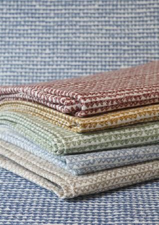 Fermoie -  Fermoie Fabric Collection - Tiny triangles patterning folds of white, blue, green, beige, red and mustard yellow coloured fabrics