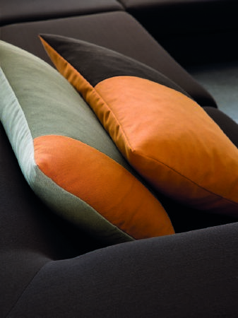 Fibre Naturelle -  Boston Fabric Collection - Rectangular scatter cushions made with blocks of orange, light green, dark brown and cream colours on a plain, simple dark brown-grey sofa