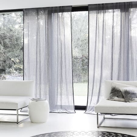 Fibre Naturelle -  Breeze Fabric Collection - Minimalist transparent curtains dyed in white featuring black edges and minimalist white furniture