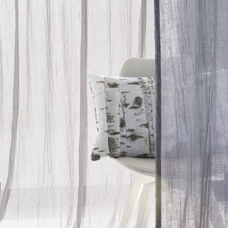 Fibre Naturelle -  Breeze Fabric Collection - White leather chair with a white cushion featuring abstract grey design surrounded by transparent white fabric