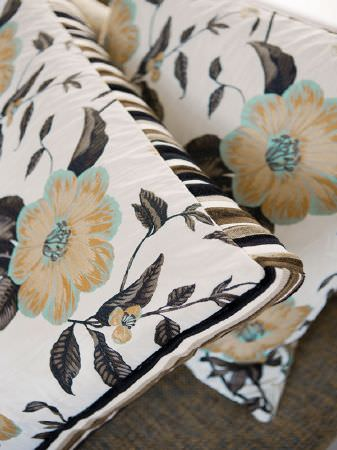 Fibre Naturelle -  Florence Fabric Collection - Gold floral print square cushion with pale blue highlights, dark brown and black leaves on a cream background