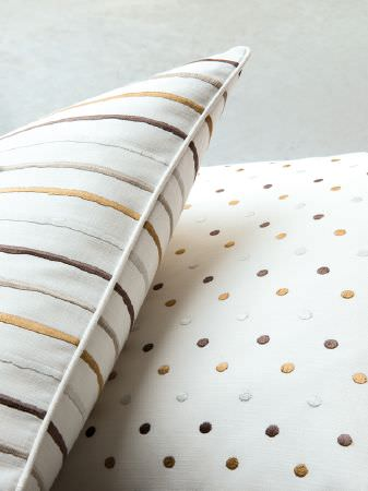 Fibre Naturelle -  Henley Fabric Collection - One white cushion with a polka dot pattern, one white cushion with a striped design, both in dark brown, beige and gold