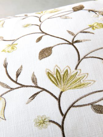 Fibre Naturelle -  Henley Fabric Collection - An embroidered design of florals and leaves created in shades of dark brown and kiwi green on plain white fabric
