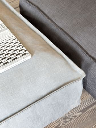 Fibre Naturelle -  Kingsley Fabric Collection - Two large square floor cushions placed on wooden planks, made in plain light grey and plain dark grey