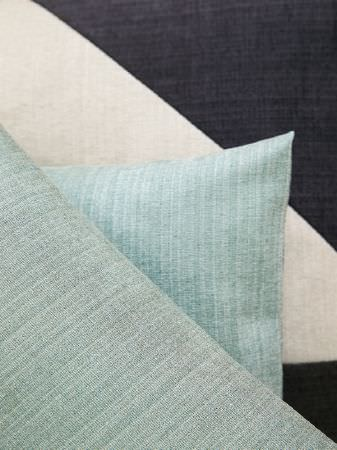 Fibre Naturelle -  Madison Fabric Collection - Charcoal and white geometric shapes made into a fabric behind 2 scatter cushions made in a light mint-duck egg blue colour