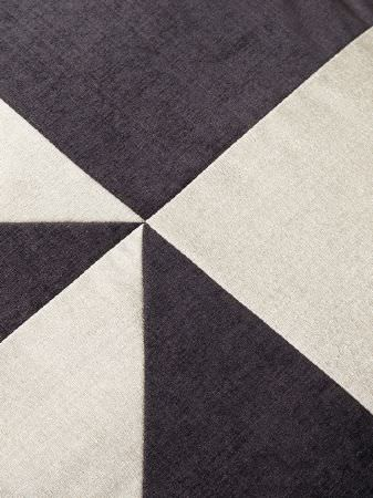 Fibre Naturelle -  Madison Fabric Collection - A geometric design created by stitching together large triangles and squares made from plain charcoal and grey-white fabrics