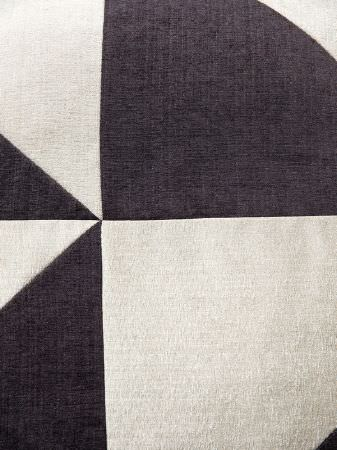Fibre Naturelle -  Madison Fabric Collection - Large triangles of different sizes stitched together into a plain charcoal and pale grey-white coloured geometric design
