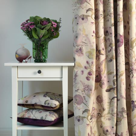Fibre Naturelle -  Melody Fabric Collection - Beige curtain decorated with purple flowers and two beige cushions featuring the same design