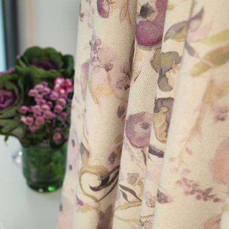 Fibre Naturelle -  Melody Fabric Collection - Close-up view of a curtain dyed in beige and decorated with an elegant pattern of purple flowers